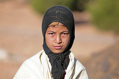 SAHARA DESERT, MOROCCO 19 OCTOBER 2013: Young nomad woman in the Royalty Free Stock Photo