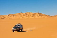 Sahara Desert Safari. Off-road vehicle driving in the Awbari Sand Sea, Libya royalty free stock photos