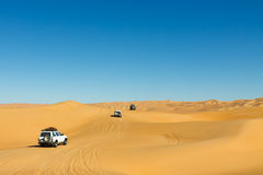 Sahara Desert Safari. Off-road vehicles driving in the Awbari Sand Sea, Libya stock photo