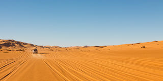 Sahara Desert Safari. Off-road vehicles driving in the Awbari Sand Sea, Libya stock image