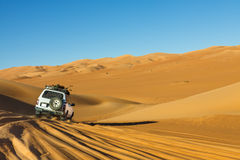 Sahara Desert Safari. Off-road vehicle driving in the Awbari Sand Sea, Libya stock photography