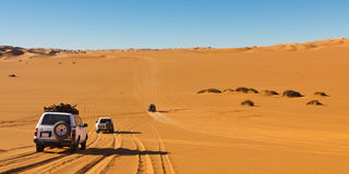 Sahara Desert Safari. Desert Safari - Off-road vehicles driving in the Sahara Desert, Libya stock image