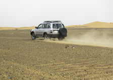 Sahara desert safari. Off-road vehicle driving in Morocco Royalty Free Stock Image