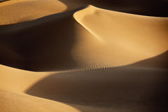 Sahara desert sand dunes. Picture of sand dunes with shadows in the Sahara desert of Morocco Royalty Free Stock Photos