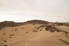 Sahara desert in Sudan with big boulders in the dunes stock images