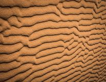 Sahara desert texture, orange sand patterns. Texture of the Saharan desert, orange color of the sand of the Sahara, Erg Chigaga, Morocco. Textures sinuous forms Royalty Free Stock Photos