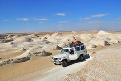 Safari in Sahara, Egypt. Sahara, Egypt - December 26, 2008: Off-road car shown in the Tent valley desert. Extreme desert safari is one of the main local tourist stock image