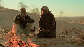 Sahara men near a fire. Two men camping in the sahara desert stock video