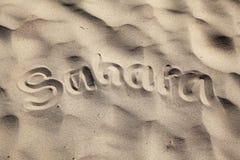 Sahara - tittle at desert. Spain - tittle at sandy beach Stock Photos
