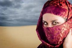 Saharawi Women Garnet Dress, Desert Background Stock Photos