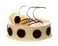 Sahnekuchen mit Schokolade auf dem weißen Hintergrund lizenzfreies stockbild