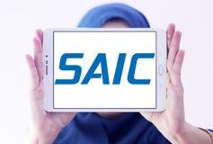 SAIC, Science Applications International Corporation logo. Logo of SAIC, Science Applications International Corporation on samsung tablet holded by arab muslim Royalty Free Stock Photography