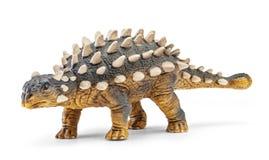 Saichania在与裁减路线的白色背景隔绝的恐龙玩具 库存照片