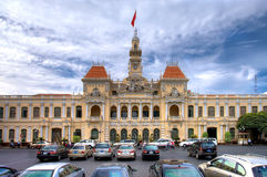 Saigon city hall. HCMC, VIETNAM-JAN, 9: Many cars parked in front of The People's Committee building, also named Hotel de Ville, located in Saigon, Ho Chi Minh Stock Images