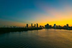 Saigon at sunset. Saigon downtown at sunset, view from across the Saigon river royalty free stock photos