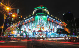 Saigon Tax Trade Center by night in Ho Chi Minh City Stock Photo