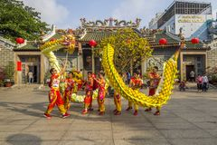 SAIGON, VIETNAM - FEB 15, 2018 - Dragon and lion dance show in chinese new year festival. Dragon and lion dance show in chinese new year festival at Chinatown royalty free stock photo