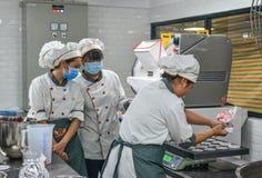 People working at bake factory. Saigon, Vietnam - Jan 9, 2019. People working at bake factory in Saigon Ho Chi Minh City, Vietnam royalty free stock photos