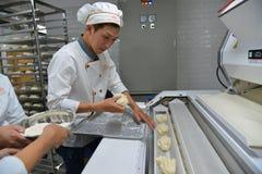 People working at bake factory. Saigon, Vietnam - Jan 9, 2019. People working at bake factory in Saigon Ho Chi Minh City, Vietnam stock photo