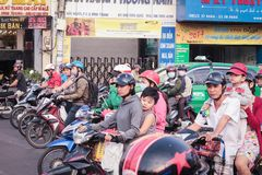 Many scooter driver and motorbikes at traffic light on Saigon st Stock Images