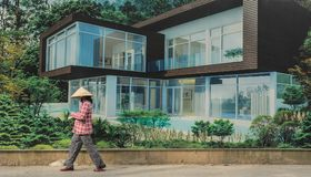 Person walking in front of Luxury real estate property advertisi Royalty Free Stock Photo