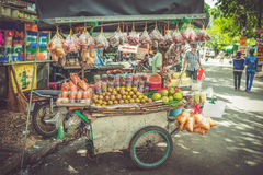 SAIGON, VIETNAM, JUNE 26, 2016: Food on Street. Fruit and snack sale in cart stock photo