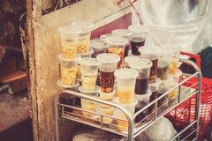 SAIGON, VIETNAM, JUNE 26, 2016: Food on Street.Vietnam Street Food, Sweet Dessert called Chè. Stock Photos