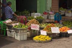 Saigon, Vietnam - June 30, 2017: Woman selling fruit on street, Saigon, Vietnam. Street market vendor selling fresh tropical fruit Stock Photo