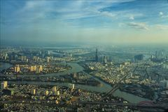 Saigon view from above. Cityview. Capital. Aerial. Skyscape. Town. Urban. River system. Street. Sky. Skyscape. Landmark. Environment. Construction. Architeture Stock Photography