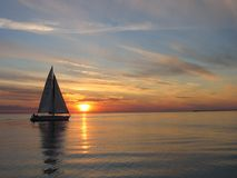 Sail. Ing an the sunset Royalty Free Stock Photography