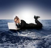 Sail. Businesswoman with laptop sinking in the sea Royalty Free Stock Photography