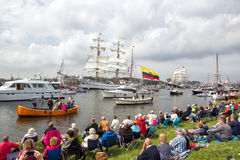 SAIL Amsterdam 2015. AMSTERDAM, THE NETHERLANDS - AUGUST 19, 2015: People watch ships passing by in the North Sea Canal enroute to Amsterdam to particiate in the Royalty Free Stock Photo