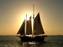 Sail away... Sailing boat and sunset Stock Images