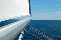 Sail away. Sailing detail - mast pointing at open sea Stock Photos