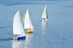 Sail away - three yachts on a river Royalty Free Stock Photos