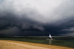 Sail in the bad weather Stock Image