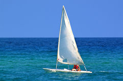 A sail in the blue sea Stock Photos