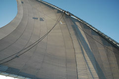 Sail and blue sky. Sail with patches of an egyptian felucca Royalty Free Stock Images