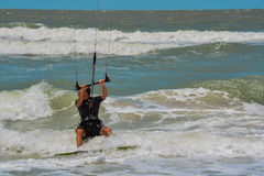 A sail boarder navigating the surf on the Gulf of Mexico in Indian Rocks Beach, Florida. USA Royalty Free Stock Photos