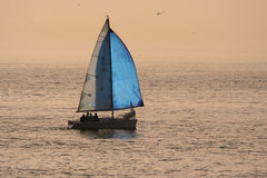 Sail boat. In a sunset sky Stock Photography