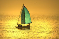 Sail boat. In a sunset sky Stock Photo