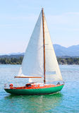 The sail boat. The sail boat in early morning on the mountain lake. Chiemsee is a biggest freshwater lake in Bavaria, Germany Royalty Free Stock Photos