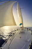 Sail boat. People on a sail boat at the sunset Stock Photos