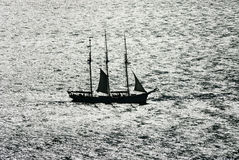 Sail boat against the light Royalty Free Stock Photography