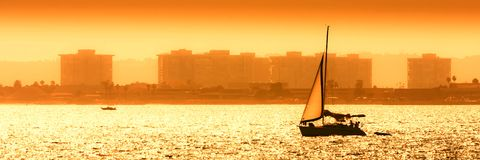 Sail boat against sea sunset Royalty Free Stock Photography