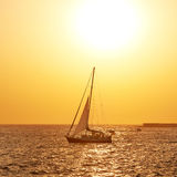 Sail boat against sea sunset Royalty Free Stock Photo
