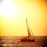 Sail boat against sea sunset Royalty Free Stock Image