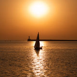 Sail boat against sunset Royalty Free Stock Images