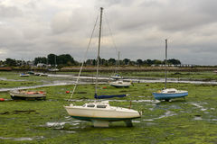 Sail boat aground at Emsworth, Hampshire Stock Photos
