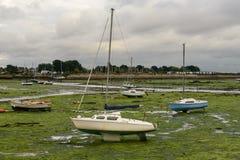 Sail boat aground at Emsworth, Hampshire Stock Photos